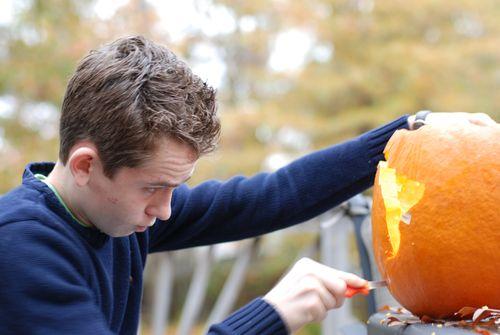 Alex carving Brazil into a pumpkin
